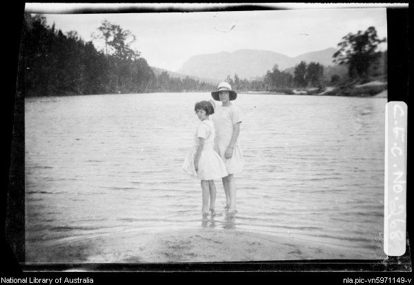 Cazneaux, Harold, 1878-1953. Joan and Rainbow standing at water's edge c1920