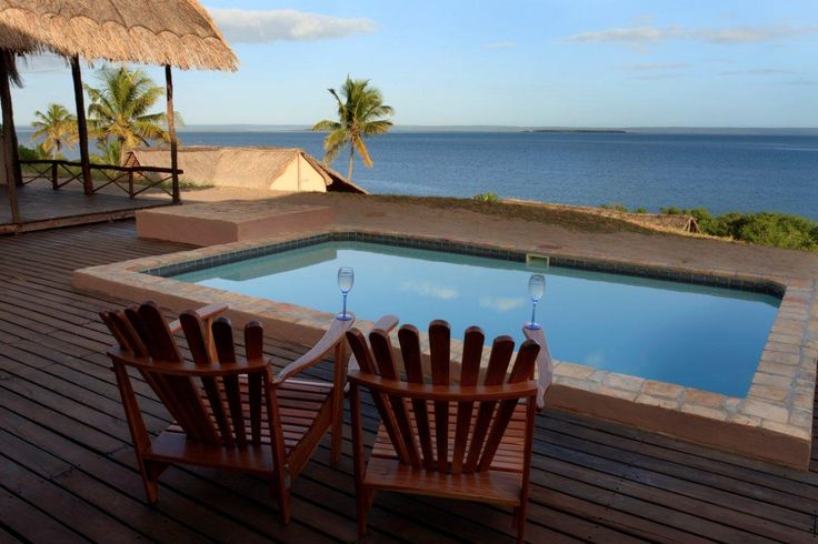 Barrabing Self Catering Holiday Home In Barra, Mozambique See more on https://goo.gl/BA8evY  Barrabing, built on the banks of the lagoon at Barra, Inhambane, overlooks the lagoon, melting into the sea in the distance. The house has 4 bedrooms, each with an en-suite bathroom, a spacious, fully equipped kitchen and braai facilities. The deck faces the lagoon, and offers arguably the best views of the pristine tidal bay of Inhambane.