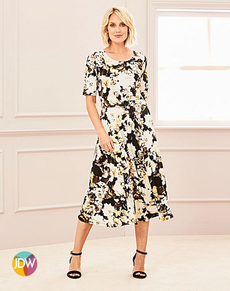 5fc76666d9d0 This stunning floral print would be perfect for a spring/summer wedding.