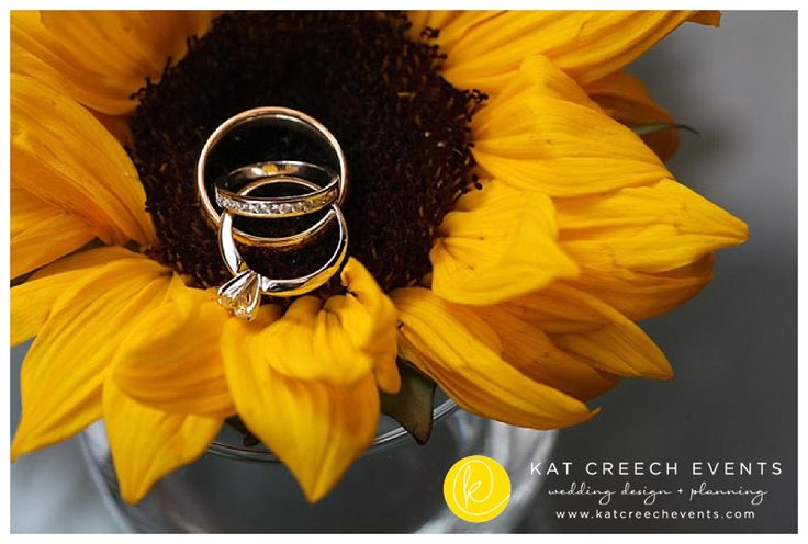The wedding rings placed in a sunflower sets the tone for this wedding. www.KatCreechEvents.com