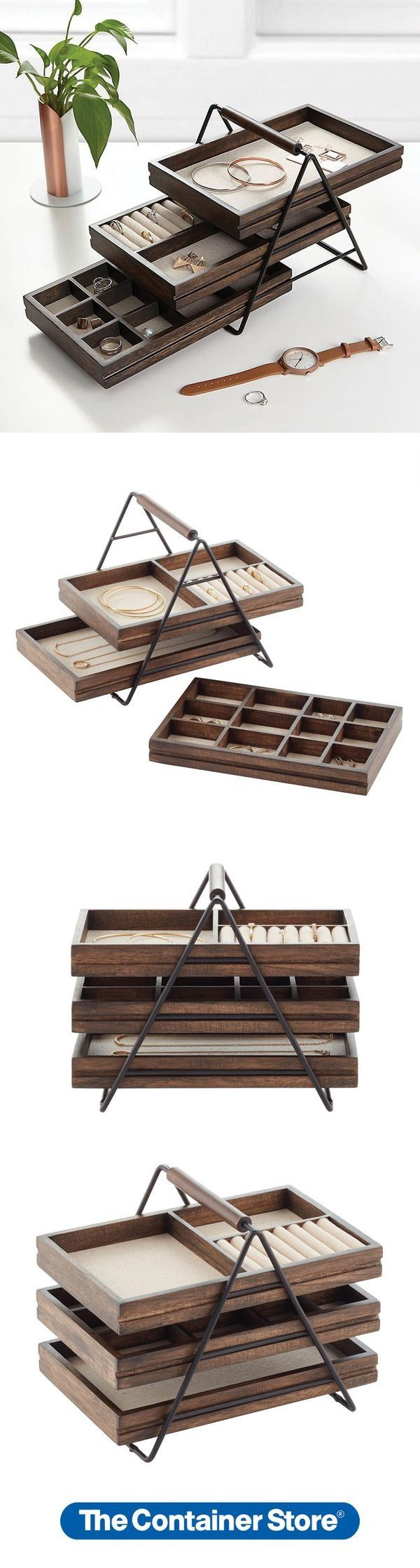 Thoughtfully designed to take up minimal space on a dresser top, the Terrace Jewelry Organizer by Umbra actually hides an impressive amount of storage space. Its three wooden tiers slide out, revealing trays for specialized organization: a divided bottom tray for earrings, middle tray with rings rolls and compartment for chains or eyeglasses, and a top tray for necklaces and larger accessories. Each is open for easy access and linen-lined to protect contents.