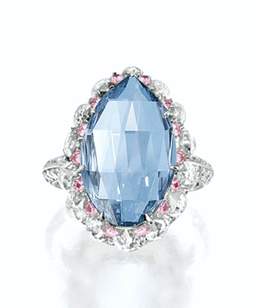 UNIQUE FANCY VIVID BLUE DIAMOND, PINK DIAMOND AND DIAMOND RING. Set with a modified pear double rose-cut diamond weighing 5.00 carats, amid a stylised support set with briolette diamonds together weighing approximately 6.69 carats, decorated with brilliant-cut pink diamonds and diamonds, mounted in 18 karat white and pink gold.