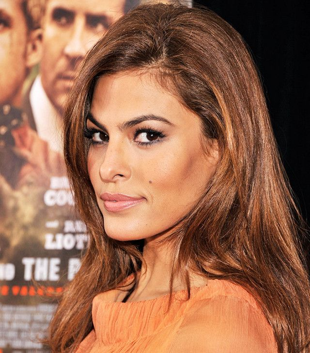 Eva Mendes stepped out with a seductive eye makeup look to perfectly complement her bronze hair
