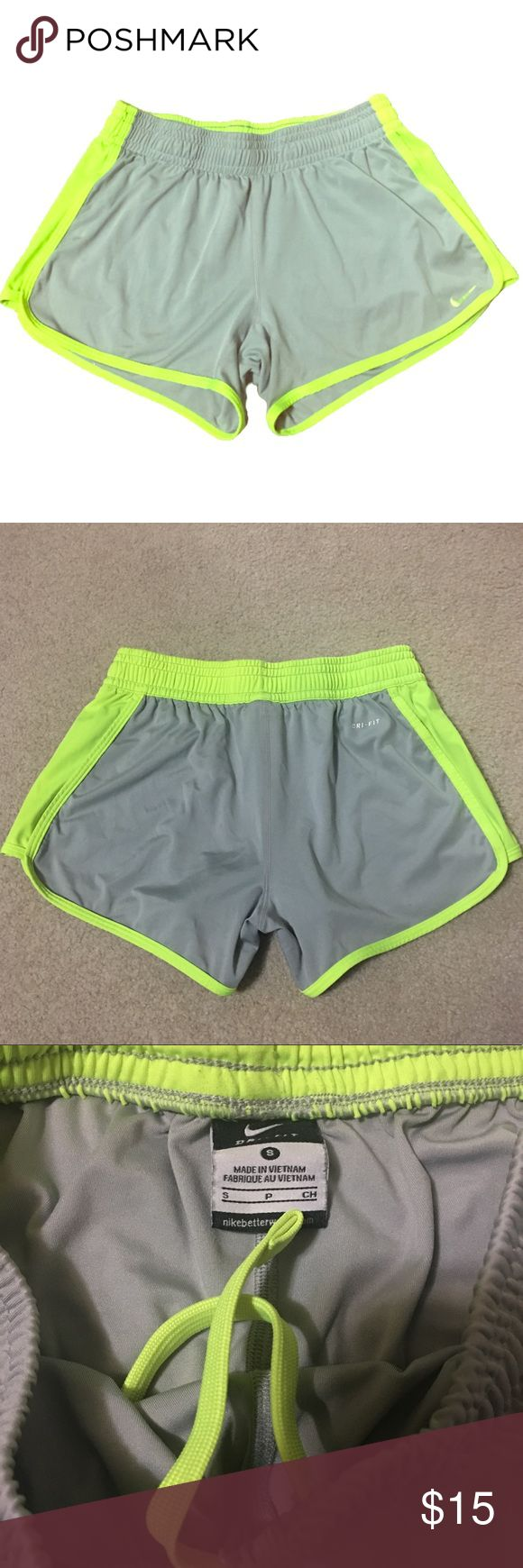 Nike dri fit neon detail shorts Light grey and neon green shorts   Waist tie and band that can be folded over   Dri fit comfortable material  In good gently used condition - no snags Nike Shorts