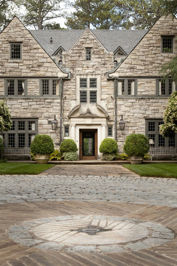 Front Motor Court With Mill Stone And Family Crest By