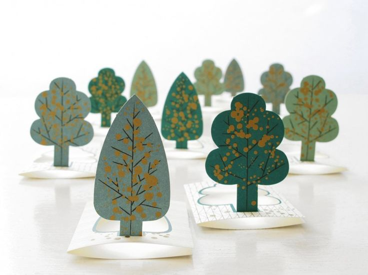 Forest or paper tree pop-up cards by Jurianne Matter also look like leaves. They also make nice seating cards, invitations or gift tags. Could DIY this.