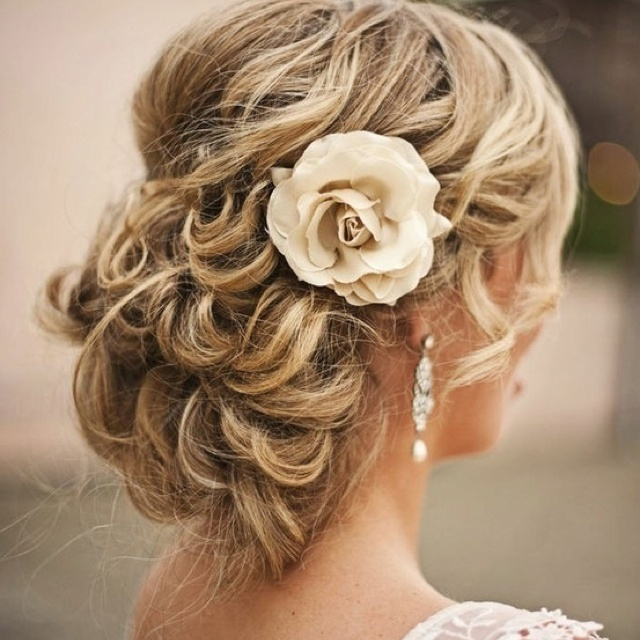 Hairstyle. Instead of the flower, a comb.