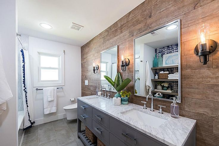 21915 Guadalupe Galveston, TX 77554: Photo Main bathroom with floor to ceiling plank-style porcelain with a wood grain glaze and double sink vanity.   This bath has fully automated floating toilet with heated seat, water jets, lights and auto lid/seat.