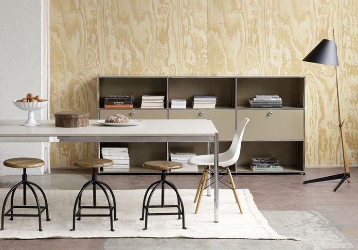 This modular storage unit features three versatile drop-down drawers
