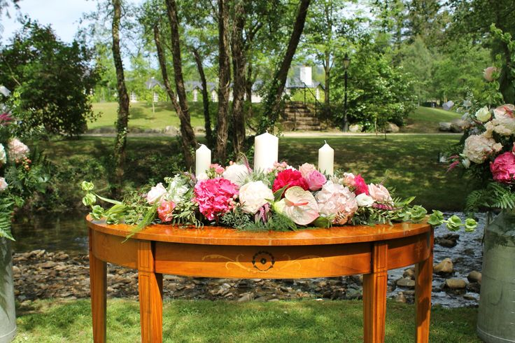 Unity arrangement in pinks with hydrangea and roses