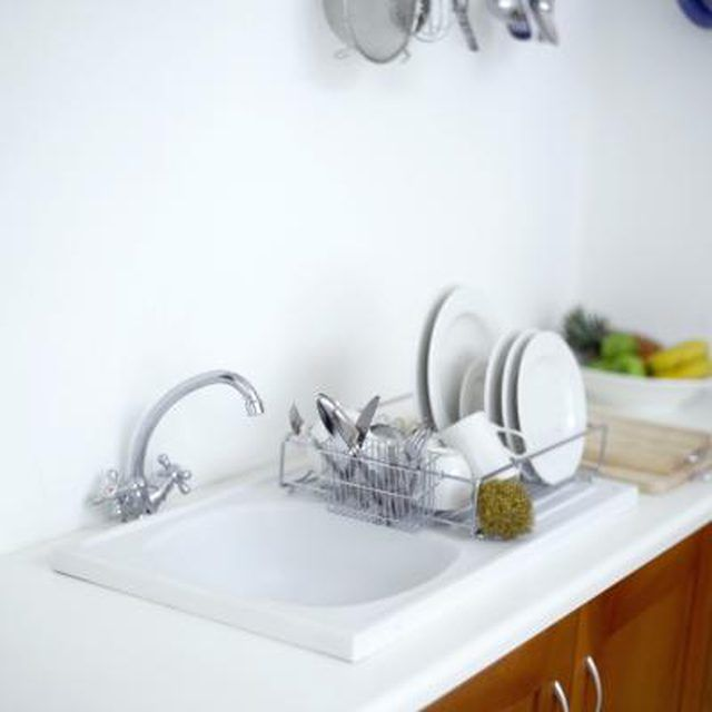 Pots, pans and silverware are common causes of aluminum scratches in a porcelain sink.