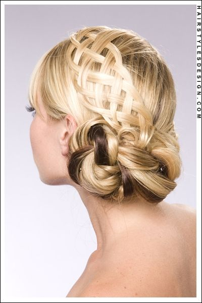 Details:  Hair Style: This updo hairstyle is romantic and perfect for a wedding or prom. This woman has her long, straight hair taken off the back and shoulders. Her hair has been styled into a braided twist right at the back. Some hair on top, has been braided which falls softly onto the head.--interesting idea. I like the bun
