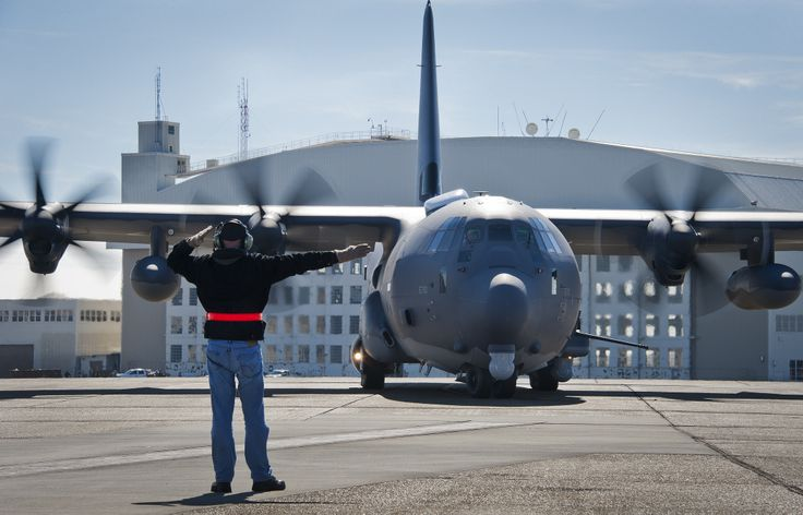 Dave King,of Lockheed Martin,marshals out AC-130J Ghostrider as taxis runway for 1st official sortie Jan.31 at Eglin Air Force Base,Fla.The Air Force Special Operations Command MC-130J arrived at Eglin in January 2013 to begin the modification process for the AC-130J,whose primary mission is close air support,air interdiction & armed reconnaissance.A total of 32 MC-130J prototypes will be modified as part of a $2.4 billion AC-130J program to grow the future fleet.(USAF Chrissy Cuttita)