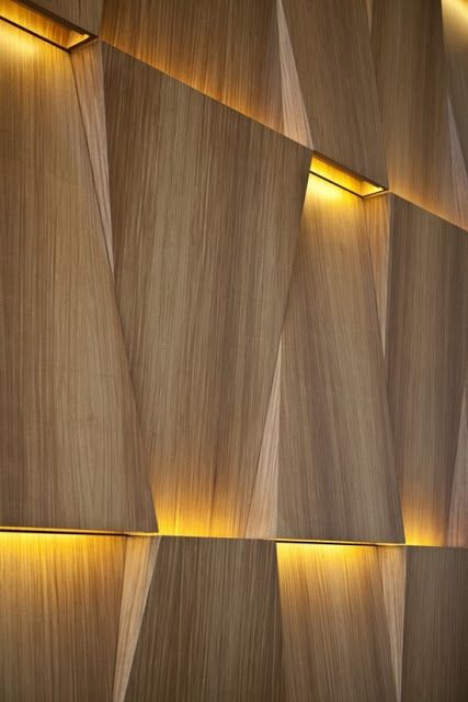 This veneer paneling is simply amazing.  Lighting is inside each of the veneer cavity reflecting light up and down.