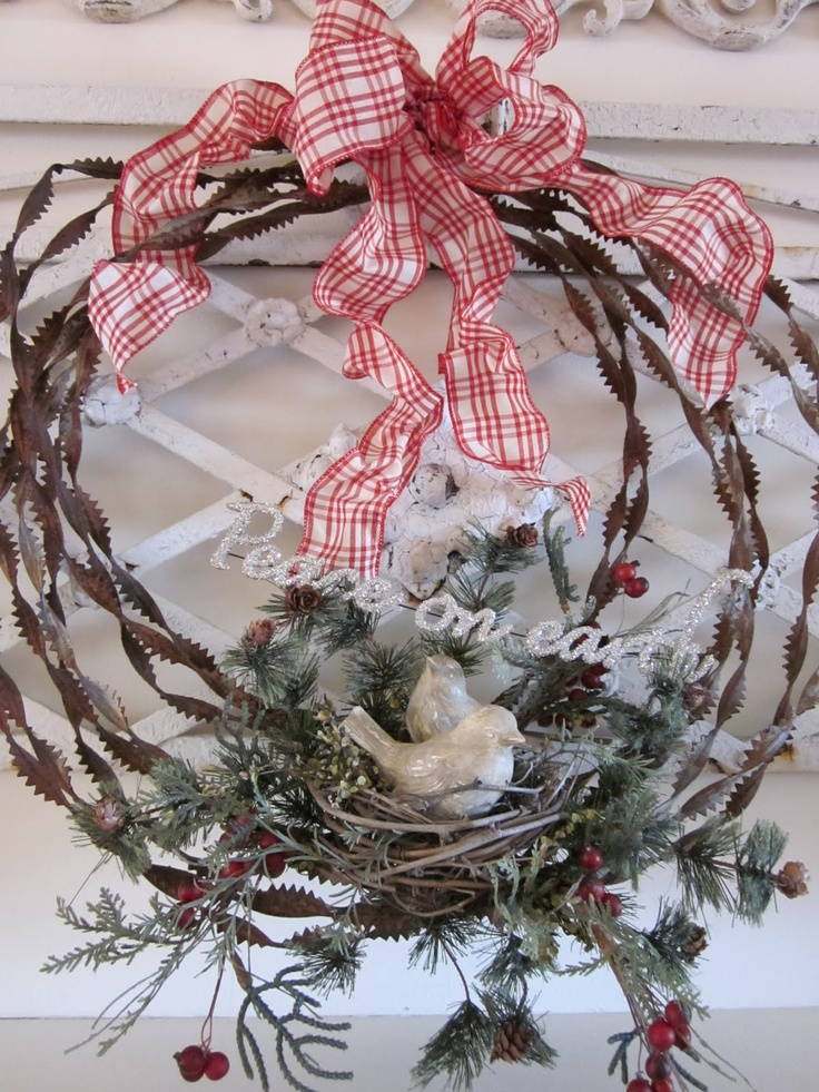 Country Christmas - thinking of something similar with barb wire wreath, homespun red check bow, mini pine greenery and mini pine cones