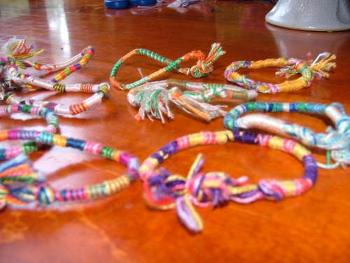 DIY string bracelets. never made these, but it seems pretty simple :)