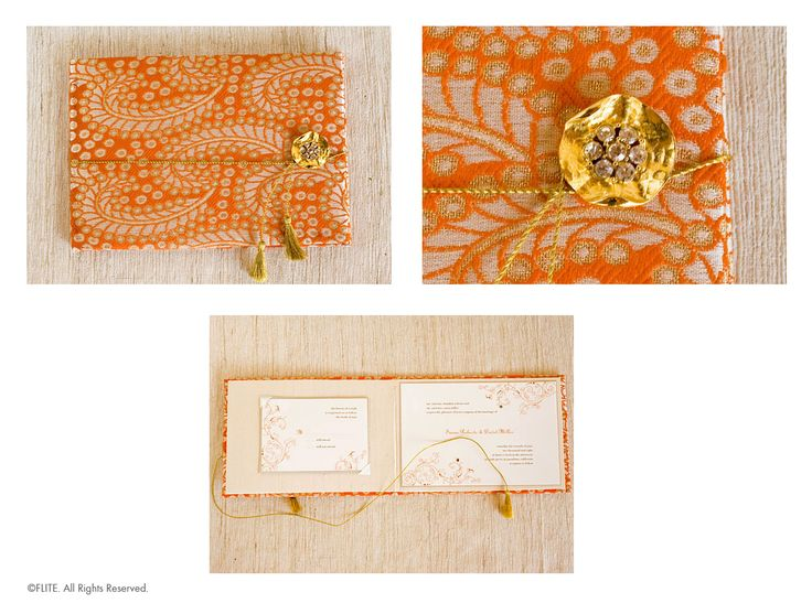 A golden lily pad holding a cluster of Swarovski rhinestones sits atop the orange and gold cushioned brocade book. Gold tassels unwind to reveal an elegantly designed invitation set against ivory silk. Two rhinestone accents embellish the graphic design. The response card is tucked into ivory satin photo corners.