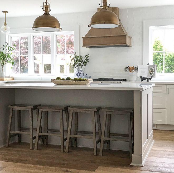 coastal farmhouse kitchen with no upper cabinets and windows flanking range hood grey k on farmhouse kitchen no upper cabinets id=34517