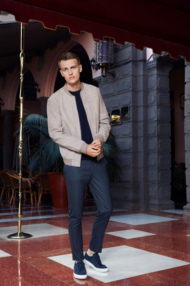 Party outfit idea for men: beige suede bomber, simple tee, tailored blue trousers and blue and white sneakers | JACK & JONES