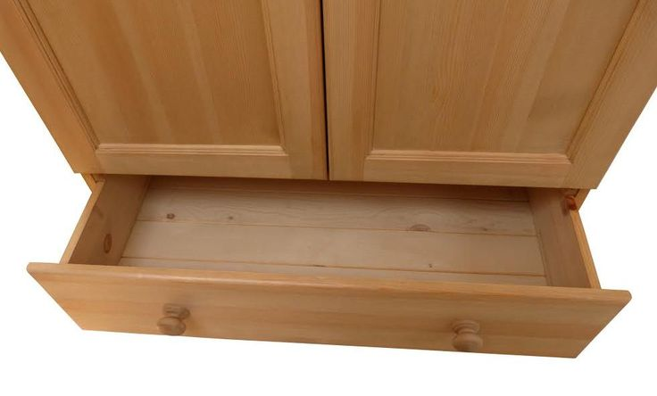The inside of one of our drawers showing pine tongue and groove base.