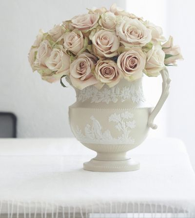 The barely there pink tint to these 'Sahara' roses pairs nicely with a beige and white Wedgwood pitcher.