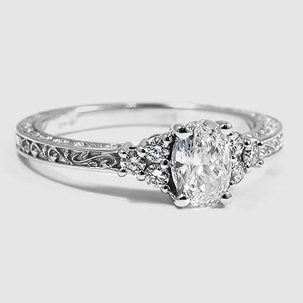 18K White Gold Adorned Trio Diamond Ring // Set with a 0.54 Carat, Oval, Good Cut, I Color, SI1 Clarity Diamond #BrilliantEarth