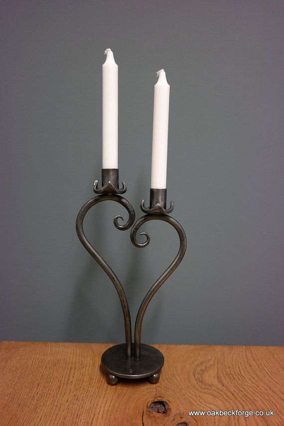 Heart Design Candle Holder  The candle holder is forged by hand making each one unique  Polished with a Wax finish.  Mild steel10mm bar  Approx