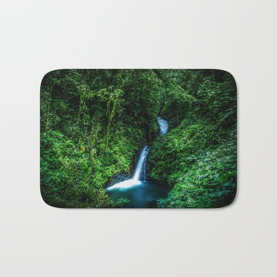 Jungle Waterfall Bath Mat. A small glade opens up with a beautiful waterfall deep in the jungle of the Cloud Forest Reserve of Monteverde, Costa Rica. #forest #rainforest #nature #green #landscape #waterfall #rug #homedecor #bathmat