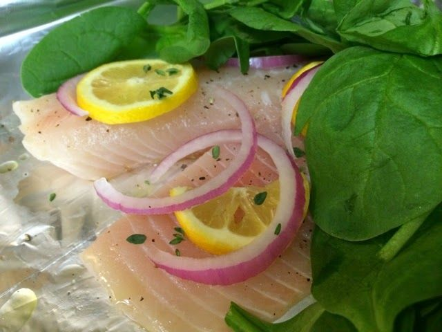 Baked tilapia pre heat oven to 400 39 place fresh fish in for Fish foil packets oven