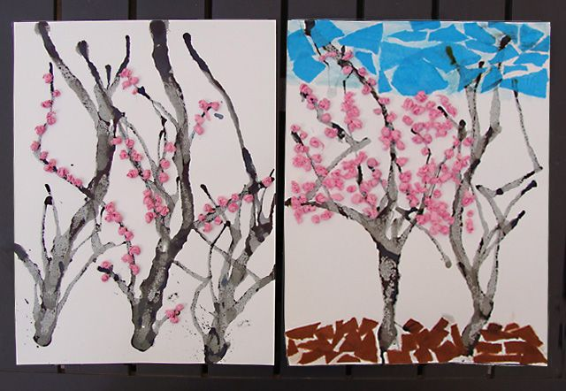 Cherry or almond blossom pictures made by blowing ink through a straw for the trees and attaching pink tissue paper balls.