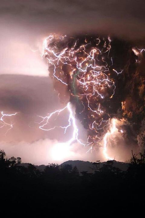 An intense lighting storm in the middle of a tornado.