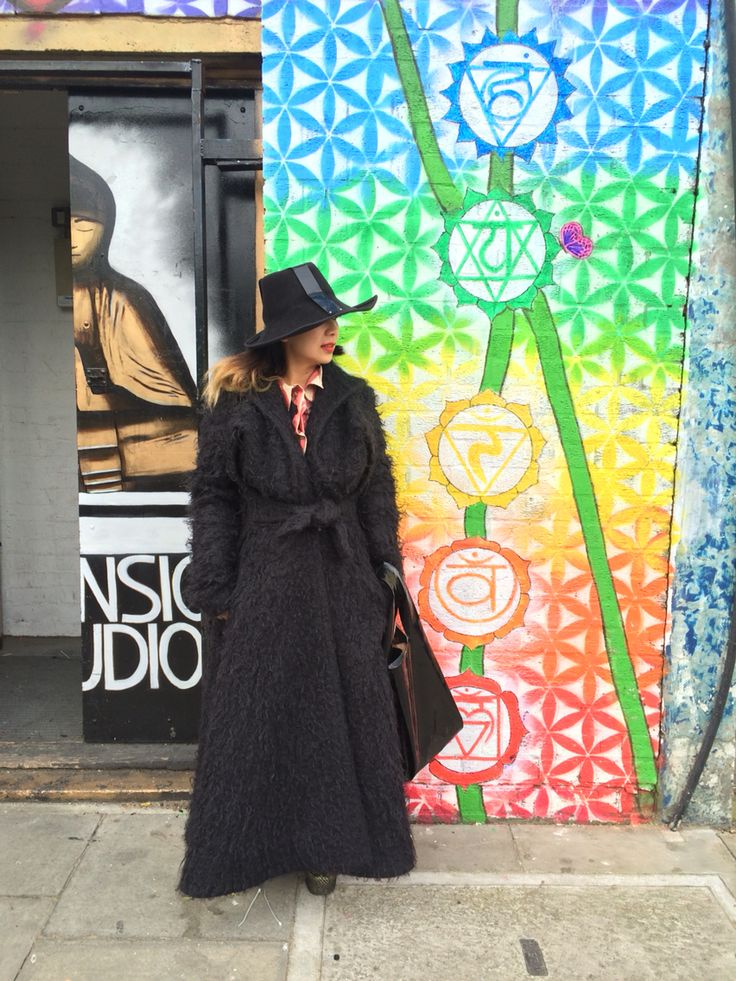 East London life interview with accessory designer Sarah Anglo at Hackney with Vivienne Westwood coat and Noel Stewart Hat