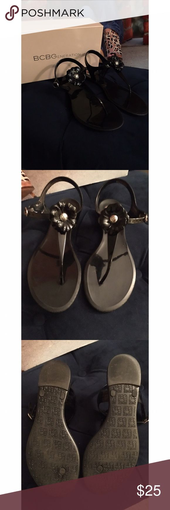 BCBG Black Jelly Sandals BCBG Black Jelly Sandals. Durable hard plastic sandal perfect for the beach or vacation. Easy to wipe clean. Some slight signs of wear which is not visible while wearing. Black color and material camouflages signs of wear 🙌🏾 Make me an offer 😉 BCBG Shoes Sandals