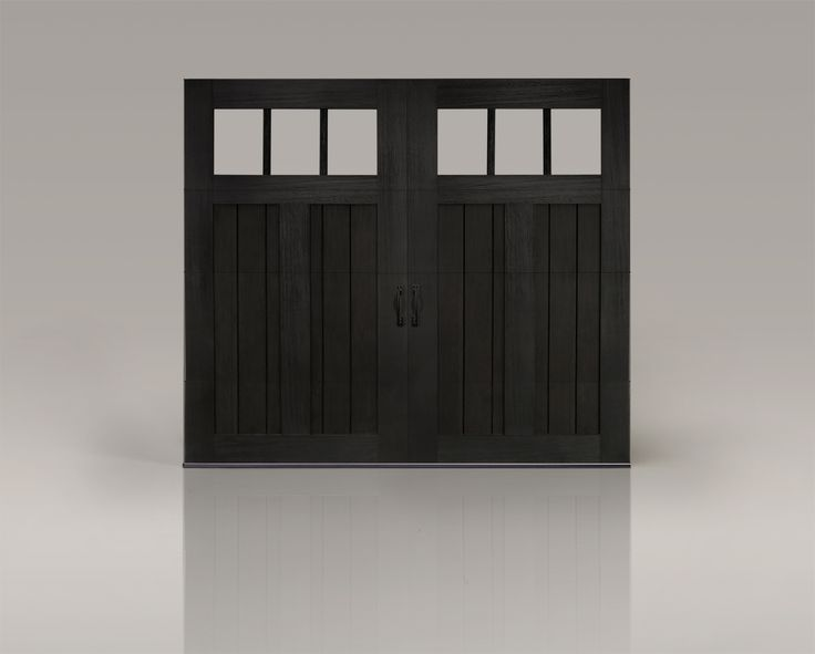 A painted black garage door with windows is perfect for a