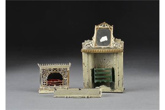 An Evans & Cartwright tinplate fireplace, cream and gold with green grate - 43?4in. (12cm.) high;