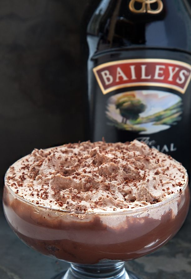 A dark chocolate flourless sponge base covered in thick Baileys Original Irish Cream infused milk chocolate ganache and topped with chocolate and Baileys whipped cream.