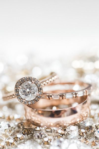 Round cut, gray diamond halo, and rose gold setting: http://www.stylemepretty.com/2015/05/16/23-vintage-inspired-engagement-rings/