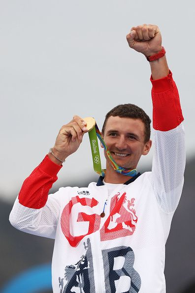 Giles Scott of Great Britain celebrates winning the gold medal in the Finn class…
