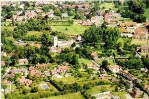 Aerial view of East Hendred showing St Augustines Church in the middle of the photo.