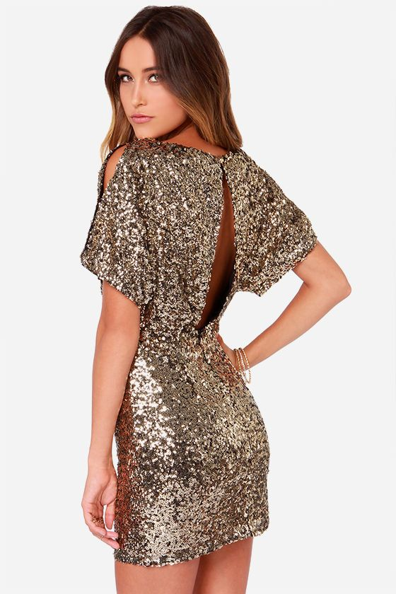Lulus Exclusive! Dazzle up your wardrobe and let it shine like gold in the Glory Never Fades Gold Sequin Dress! A sultry boat neck bodice has short dolman sleeves with slits along the tops, and tucks into an elastic waistline and fitted tube skirt. Open back slit has a top button closure. Hidden back zipper/clasp closure.