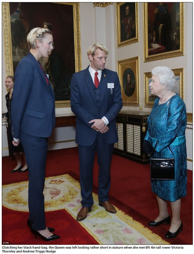 clutching-her-black-hand-bag-the-queen-was-left-looking-rather-short-in-stature-when-she-met-6ft-4in-tall-rower-victoria-thornley-and-andrew-triggs-hodge