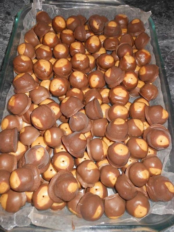 Ingredients 16 oz. peanut butter 1 pound confectioners sugar 1.5 sticks (3/4 cup) butter How to make it melted chocolate bark for dipping -Mix together the peanut butter, sugar and butter. -Roll into balls, insert tooth pick (to dip easier) and chill in freezer about 30 mins. -Dip into melted chocolate, place onto cookie sheet lines in wax paper *best stored in the fridge. *coconut pecan cake icing and coconut flakes can be added to the mixture for new taste!