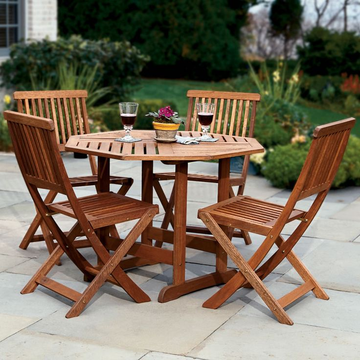 the trestle patio table and stow away chairs hammacher schlemmer