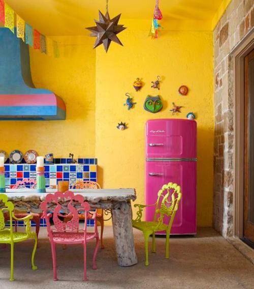 I love this color combination, that hood, the pink fridge, the til...this space is awesome!