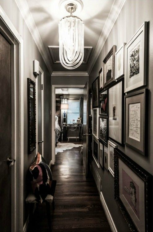 Hallway with lots of frame . . . A great idea to display personal images with art works!
