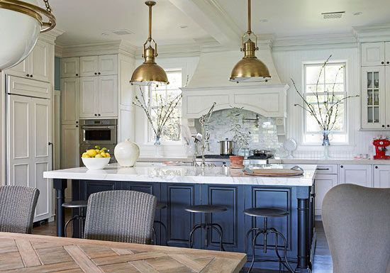 Crema Stone on the perimeter countertops and Calacatta marble on the island.