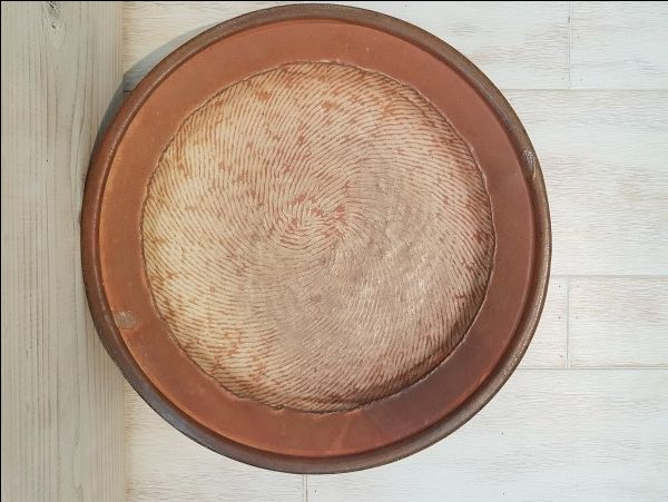 Plate (Charger), by Jane Shellenbarger. Soda fired stoneware.