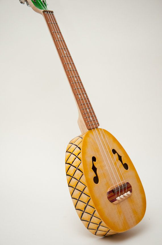Pineapple ukulele  (relief carved sides and back). via Etsy.