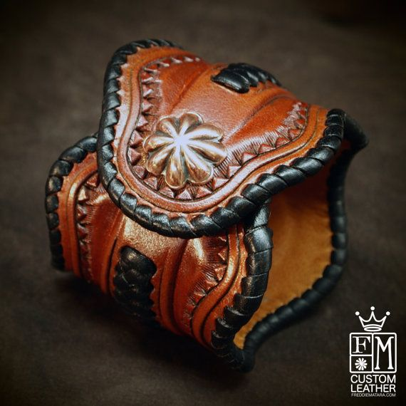 This leather cuff uses the highest quality natural vegetable-tanned leather and is hand tooled with a beautiful stamped border and whipstitched in wide chocolate kangaroo lace. The cuff is shaped in a western border style and airbrushed a beautiful rich russet brown. Applique braiding with kangaroo lace sit on either side of the center concho and a beautiful copper concho adorns the center and another provides the snap closure. I Can size it for men or women!!! Instructions in the pics above…