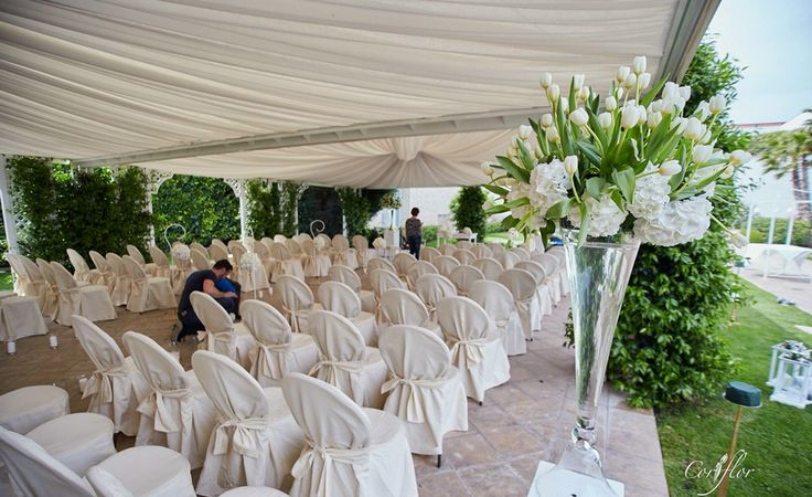 Outdoor floral installation with lovely details along aisle..chic gold and white Flowers: Corflor  wedding florists White tulips and hydrangeas